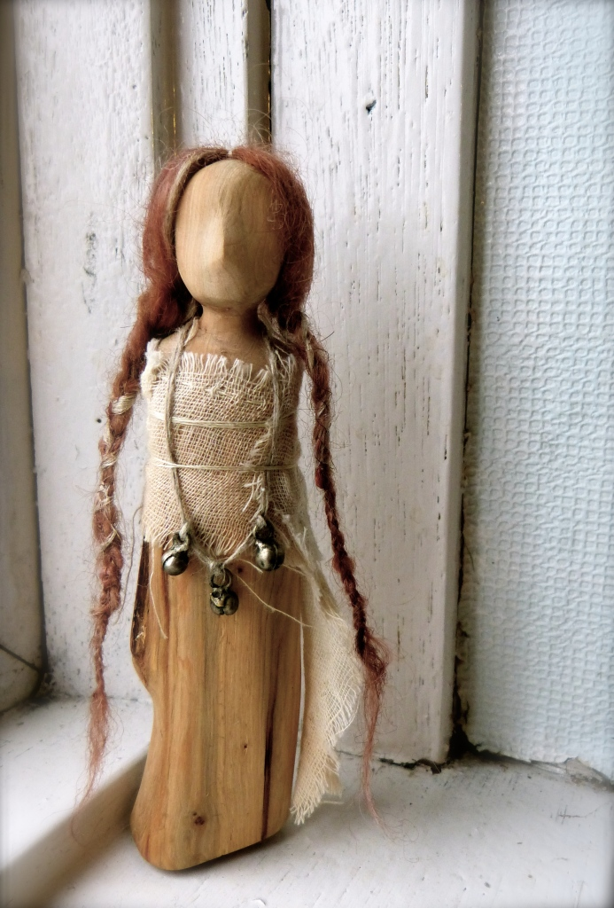 Carved Juniper wood doll